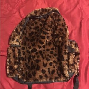 A leopard print book bag